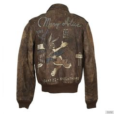 A-2 jacket belonging to 1st Lieutenant Dan C Knight, pilot of B-17 'Mary Alice' of the 615th Bomb Squadron, 401st Bomb Group (Deanethorpe). It is known that the artist who decorated this jacket had no brown paint, therefore he used cocoa powder mixed with paint to achieve the desired colour of the rabbit figure. A well-known photograph of this jacket exists showing King, back to camera, standing by 'Mary Alice