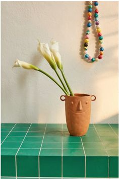Keeping your latest bouquet of flowers company, this ceramic vase features a sculpted face design. Available exclusively at Urban Outfitters. Face Planters, Indoor Planters, Planter Pots, Planter Ideas, Urban Outfitters, Clay Box, Floral Comforter, Face Design, Ceramic Vase