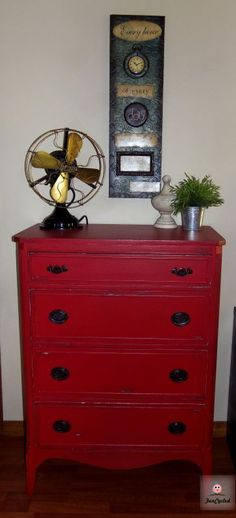 Thinking a red dresser in Rylee's room with black hardware to match black iron bed.