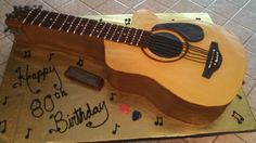Guitar cake all buttercream with a few fondant embellishments and chocolate bars for the neck of the guitar.