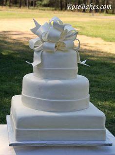 Elegant White Wedding Cake... A little plain, but I could fix that