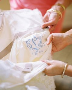 An embroidered label with the bride's monogram and the wedding date sewn into the gown. / pic by Nancy Ray Photography
