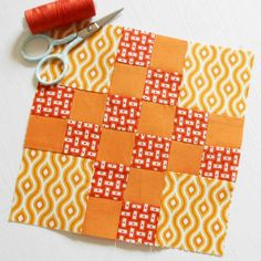 "Block 143 - Orange Squeeze. This is block 7 from ""100 Modern Quilt Blocks"" - patched."
