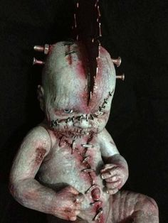 The doll itself is creepy but the sawblade in the head is extra freaky. Nice effect.