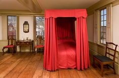 Curtains on a four poster bed. Wonderful interior shots by Michael Fredericks.