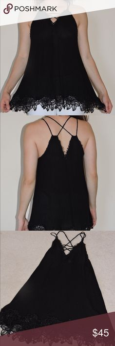 Free People Black Tank Top Free People black tank top with flower detail around the bottom and a cross cross strap design. Free People Tops Tank Tops