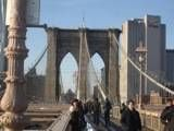 Walking across the Brooklyn Bidge. see also http://video.about.com/gonyc/How-to-Walk-the-Brooklyn-Bridge.htm