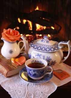 Tea and roses beside the fire, just right for a rainy day. Now, for just the right book...