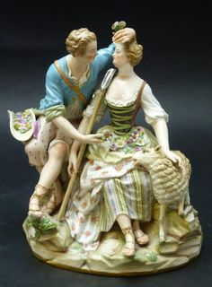 19th CENTURY MEISSEN GROUP 'SHEPHERD LOVERS' A41. A Meissen German porcelain hand painted group sculpture depicting two 'Shepherd Lovers'. The man is wearing blue coat and holding flowers towards his seated female companion, a sheep beside them, on oval rockwork base. After a model by J.J. Kaendler. Circa late 19th century and marked with under glaze blue crossed swords mark. Holds impressed A41. and impressed 66 painter's mark.