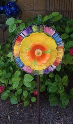 It's all about color. Color adds so much life to your yard and garden and this plate flower garden art will do that. Made with recycled/repurposed items from the home.