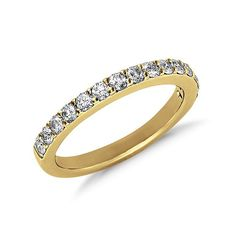 Brides.com: . Style 38641, pavé diamond ring in 18K yellow gold, $1,260, Blue Nile  See more Blue Nile rings.