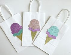Beautiful handmade ice cream party favor bags! Perfect for your little ones ice cream themed party. These bags are approximately 5 inches in width and 8 inches in height. They are craft paper bags custom decorated with premium grade and glitter cardstock. Please allow 1-2 week