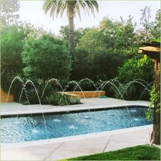 CONTEMPORARY POOL WITH UNIQUE WATER FEATURE