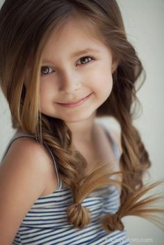 Is this litte girl not beautiful! I love her hair!