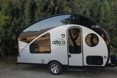Alto Safari Condo 1723 Popped Up Ultimate teardrop camper!***This is it!! All the bells & whistles of a large camper, sleeps 4 but light enough to be pulled by a small car...whoo hoo! Tests show that with roof down, it produces 75% less aerodynamic drag than a conventional 16' travel trailer. Talk about gas-friendly! The patented roof system stays lowered when stored in a standard garage or driven but can be raised to provide standing room when set up at campsite.