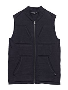 502A2   CATEGORY_ SKIN _ ARRAY VEST_ WINTER CO KNIT 7 GAUGE   Cardigan knit in slightly stretch winter cotton. On the front, 4 pockets with slanting entrance and two 'patches', all created 'in macchina', a seamless weaving construction with the body of the knit.   Rib construction for raised and folded collar.     Zip fastening.