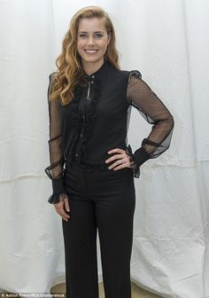 Jumping ahead in the style stakes: Amy Adams perfectly flattered her figure in a flared ju...