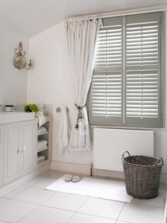 Soothing grey plantation shutters in a pretty, country-style bathroom http://www.theshutterstore.com