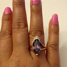 Ring. Beautiful ring purple color with 18k gold plated jewelry. No Trade. No Hold. No PayPal. Jewelry Rings