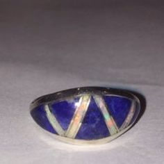 "Navajo Lapis Opal Sterling Ring Native American This is a beautiful, vintage Navajo genuine blue lapis lazuli, opal and sterling silver inlaid ring made by Navajo artisan Mark Yazzie. The ring is a size 6. It could easily be resized by a jeweler if needed larger or smaller.   The ring face is about .4"". The inlay workmanship is incredible. The ring weighs about 2 grams.   It is stamped MY Sterling, which is the hallmark for Navajo artisan Mark Yazzie. Mark Yazzie Jewelry Rings"