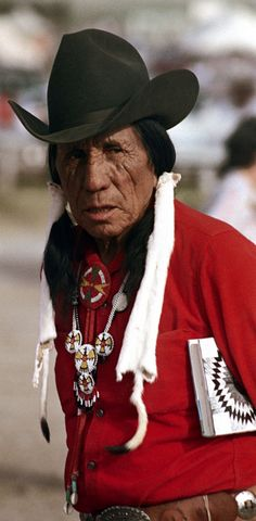 #Lame Deer  Oglala Sioux Sun Dance and Rodeo  Pine Ridge Indian Reservation, South Dakota  Photograph by Nick DeWolf (1972)  #Travel South Dakota USA multicityworldtravel.com We cover the world over 220 countries, 26 languages and 120 currencies Hotel and Flight deals.guarantee the best price