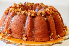 Ty's Sweet Potato Sour Cream Pound Cake with Maple Pecan Praline Sauce Sweet potato sour cream pound cake is as decadent as it sounds. Flecks of sweet potato throughout topped with a luscious maple pecan praline sauce. Sweet Potato Pound Cake, Sweet Potato Biscuits, Sour Cream Pound Cake, Sweet Potato Recipes, Cake With Sour Cream, Southern Sweet Potato Cake Recipe, Sweet Potato Dumplings, Canning Sweet Potatoes, Mashed Sweet Potatoes