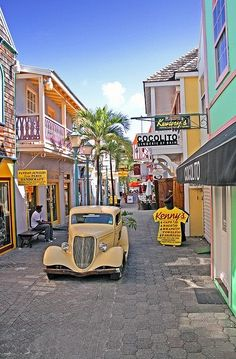 Philipsburg Old Street - St. Maarten--if I go here, will you promise that old yellow car will be coming down Philipsburg Old Street? Places Around The World, Oh The Places You'll Go, Places To Travel, Places To Visit, Around The Worlds, Dream Vacations, Vacation Spots, Destination Soleil, Trinidad E Tobago