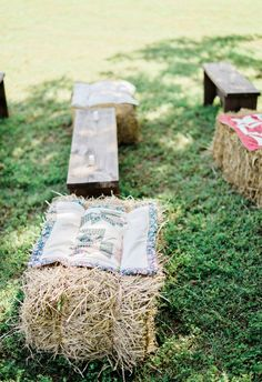 Hay bales, wooden benches, ceremony seating, quilts // Andie Freeman Photography