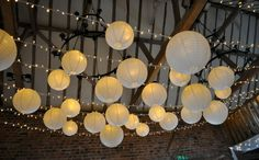 Christmas Lights with Attached Paper Lanterns - DIY Wedding Lanterns: Ideas and Guides - EverAfterGuide Cheap Paper Lanterns, White Paper Lanterns, Paper Lantern Lights, Sky Lanterns, Lantern Lamp, Lanterns Decor, Hanging Lanterns, Decorating With Paper Lanterns, Paper Lantern Decorations