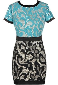 Double Date Dress: Features a swirled lace shell with neutral liner for full coverage, bold black piping bordering the neck, sleeves and hem, seafoam green upper and black lower portions, and a centered rear zip closure to finish.