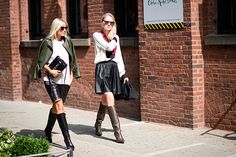 White blouse, leather skirt, and boots — here you have twice the proof that this combo is fail-safe!