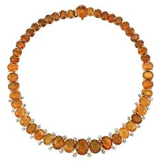 Gold, Citrine and Diamond Necklace, Van Cleef & Arpels The graduated necklace continuously set with 48 oval citrines approximately 86.70 cts., tipped by 36 old-mine-cut diamonds approximately 1.75 cts., signed Van Cleef & Arpels, N.Y., no. 20640, approximately 41.2 dwts. Length 13 inches. With signed envelope case.