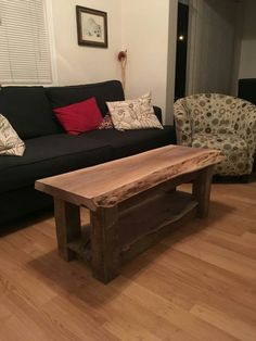 Black Walnut live edge coffee table with reclaimed 4 X 4 legs.