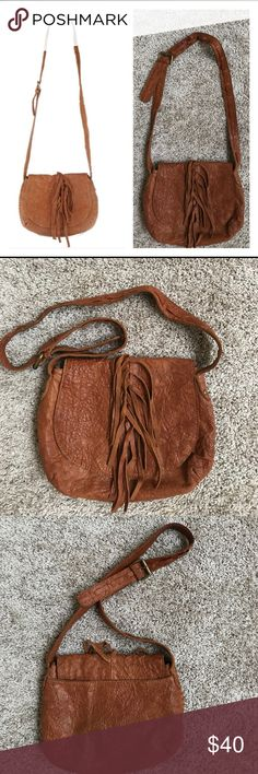 "Camilla Alves Muxo Leather Crossbody Bag EUC The always-popular crossbody bag, but with extra character. This crinkle lamb's leather bag is embellished with fringe detail on the front flap for a funky yet fashionable look. The adjustable strap fits comfortably across your body, making it an ideal everyday bag.  Snap closure, back wall slip pocket Lined interior with two front wall slip pockets, back wall zip pocket Measures 11""H x 9""W x 2""D; weighs approximately 15 oz Body/trim 100% leather…"