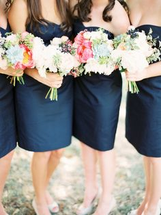 Gorgeous combination! Navy blue J.Crew bridesmaid dresses paired with coral and white bouquets.