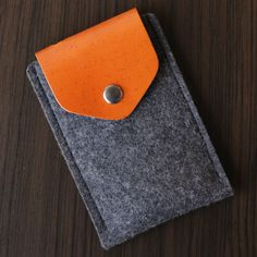 iPhone Felt / Leather Case with Secret Pocket - Dark Grey. $75.00, via Etsy.