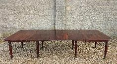 """Regency mahogany antique dining table. This table is versatile with three removable leaves and a mechanism that unbolts to create two separate tables in case the dining room needs to be used for something else. The frieze is good and narrow for maximum leg room and the legs are an especially finely turned and reeded example of this Regency period design.  English circa 1820  53½"""" wide 28½"""" high 119"""" long 9'11"""" long"""