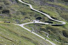 Road in Fluela Pass, a high mountain pass in the Swiss Alps; photo by pixolute, via Flickr.