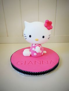 Follow this tutorial and learn how to make a Hello Kitty cake topper.
