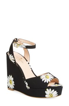 Stand tall with these printed wedge sandals from Kate Spade. Bold prints balance the chunky wedge heel and platform of a summery statement sandal secured by a slim ankle strap.