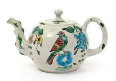 A small Staffordshire salt-glazed stoneware teapot and cover c.1750