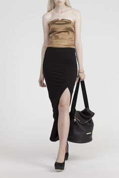 Ankle length skirt made of black organic bamboo jersey. Quality jersey is soft but thick enough to be durable and comfortable to wear. The skirt has a deep slit and pleated waistband.  Scroll down for the product DNA. The DNA reveals the people, stories and manufacturing process behind this piece.  The Lilja skirt is available in stock.