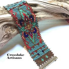 Beautiful woven bracelet with small seed beads in turquoise and deep reds. Also features Swarovski crystals. The closure is magnetic brass. Beaded Cuff Bracelet, Bead Loom Bracelets, Beaded Bracelet Patterns, Bead Loom Patterns, Woven Bracelets, Jewelry Patterns, Silver Bracelets, Fashion Bracelets, Beaded Earrings