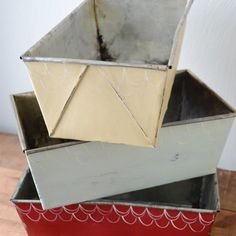 Loaf pans are cheap and easy to find at thrift stores and yard sales.  Check out how to turn them into fantastic looking storage bins!