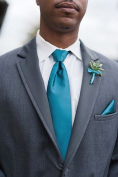 Gray and teal attire for the groom + a small succulent boutonniere.
