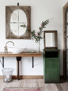 vintage bathroom with beautiful modern white sink, gorgeous old mirror and fresh roses- Tamsin Carvan and Family — The Design Files