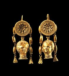 Pair of golden earrings with pendants in shape of a womans head. South Italy, Late Classical, about 350 B.C. Roman Jewelry, Viking Jewelry, Ancient Jewelry, Jewelry Art, Gold Jewelry, Antique Gold, Antique Jewelry, Vintage Jewelry, Golden Earrings