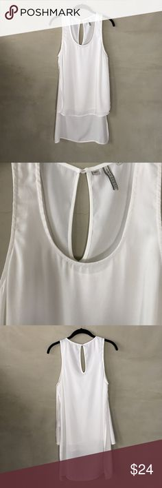 Guess white long-back sleeveless blouse Lovely flowy material, simple sleeveless blouse, longer length on posterior and inside lining for modesty. Worn less than 5 times. Guess Tops Blouses