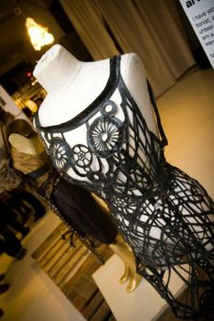 recycled!Love the lacy look of an over-dress to show off delicate items like VCR tape or laminate candy wrappers, old T-shirts, etc...