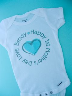 Personalized Happy First Mother's Day, 1st Mother's Day with Blue Heart Tee Shirt or Onesie. $14.99, via Etsy.